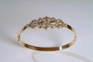Art Deco inspired gold and diamond bangle.