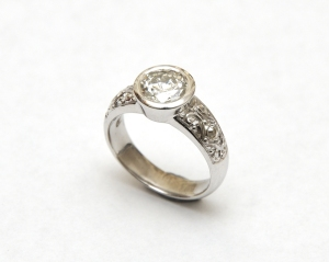 White gold and diamond, engraved engagement ring.